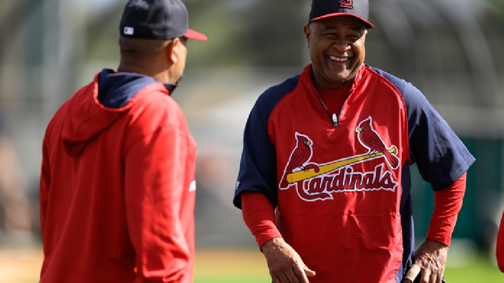 Former St. Louis Cardinals shortstop and Major League Baseball Hall of Famer Ozzie Smith, right, laughs as he talks with Cardinals third base coach Jose Oquendo during a visit to spring training baseball practice Tuesday, Feb. 18, 2014, in Jupiter, Fla. (AP Photo/Jeff Roberson)