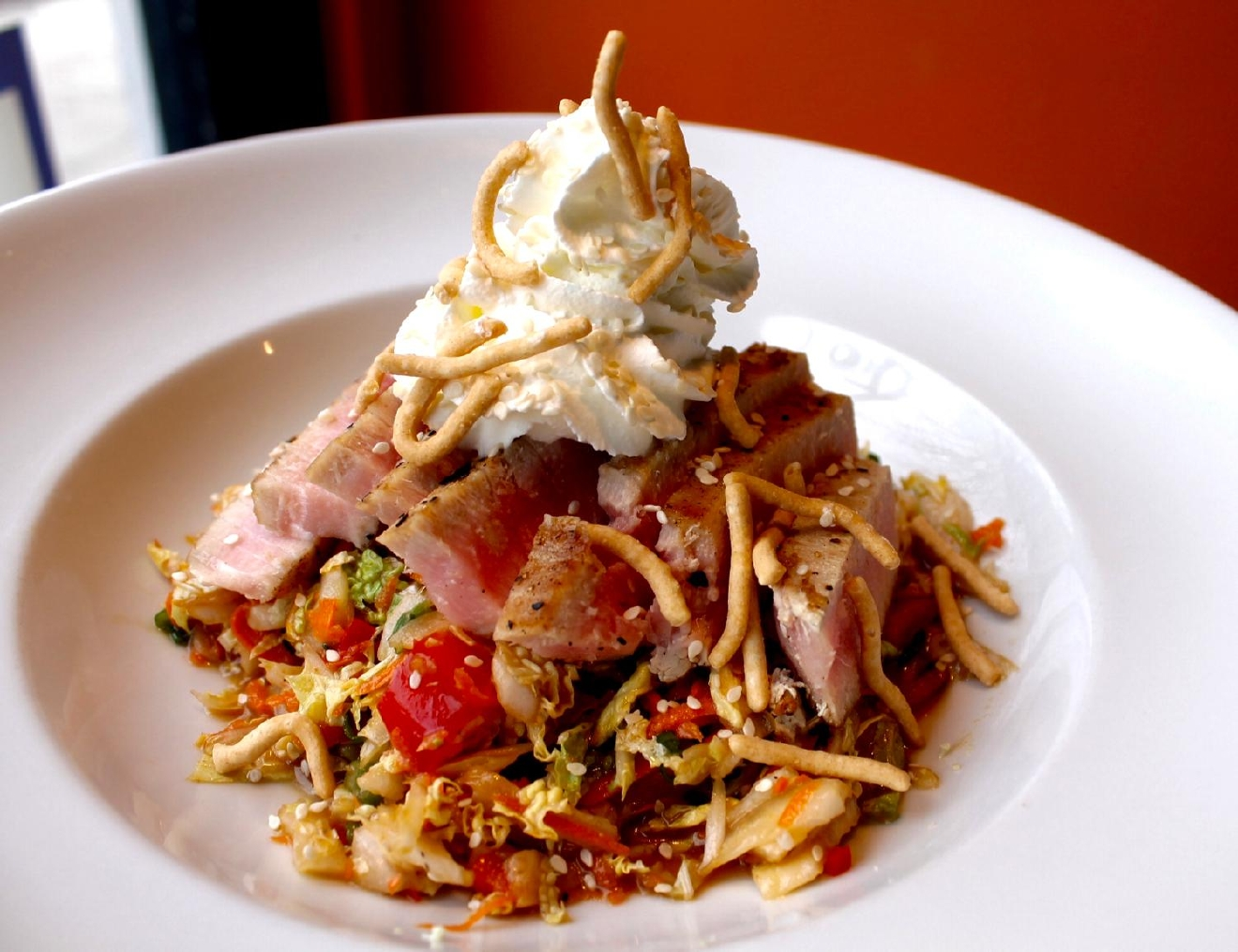 Seared Ahi Tuna : Aerated wasabi cream, Napa cabbage, carrots, red bell peppers, scallions, ginger soy dressing, and crispy chow mein noodles / Image: Rose Brewington / Published: 3.12.17