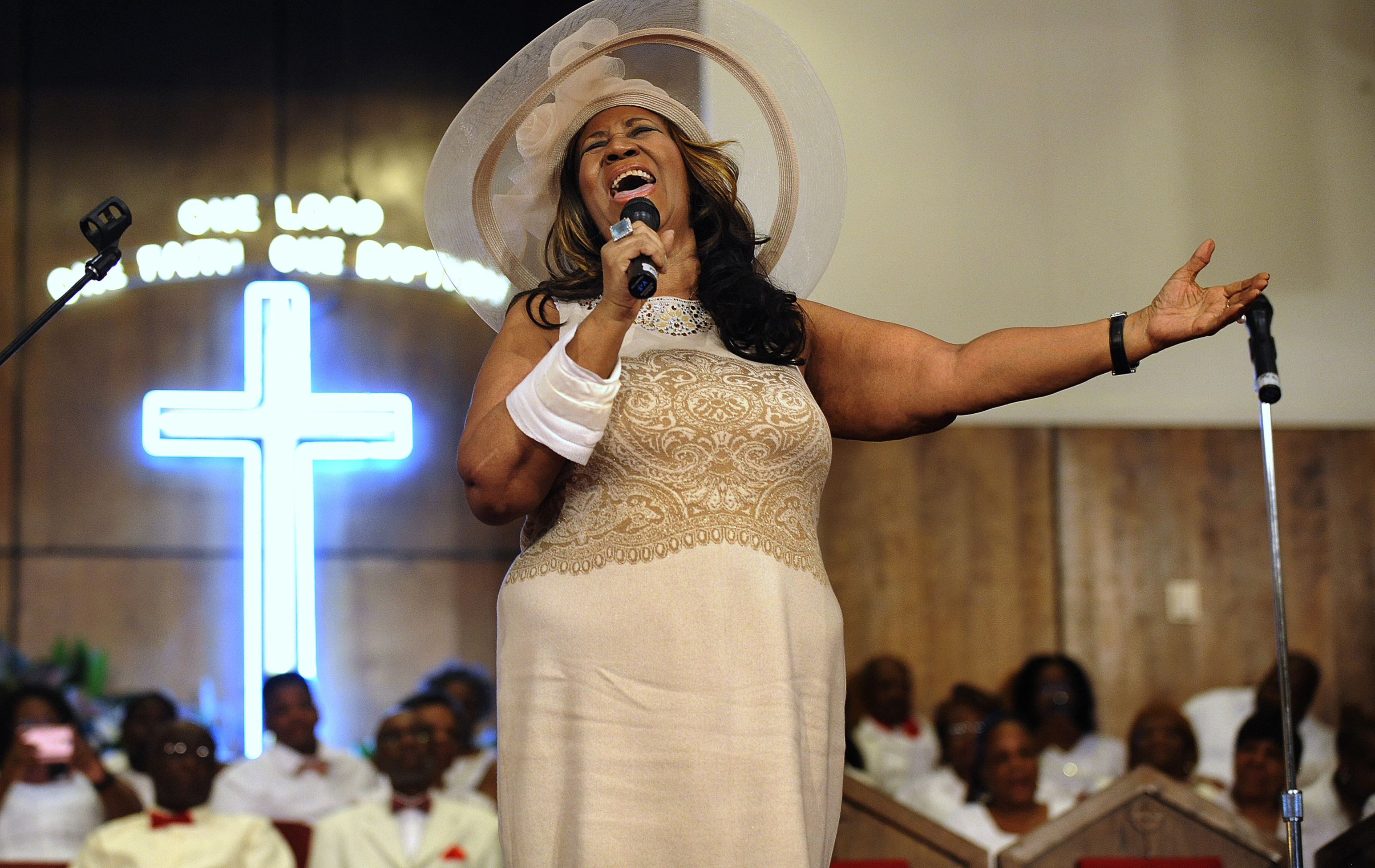 FILE - In this June 7, 2015 file photo, Aretha Franklin sings during a memorial service for her father and brother, Rev. C.L. and Rev. Cecil Franklin, at New Bethel Baptist Church where they were ministers, in Detroit. (Elizabeth Conley/The Detroit News via AP, File)