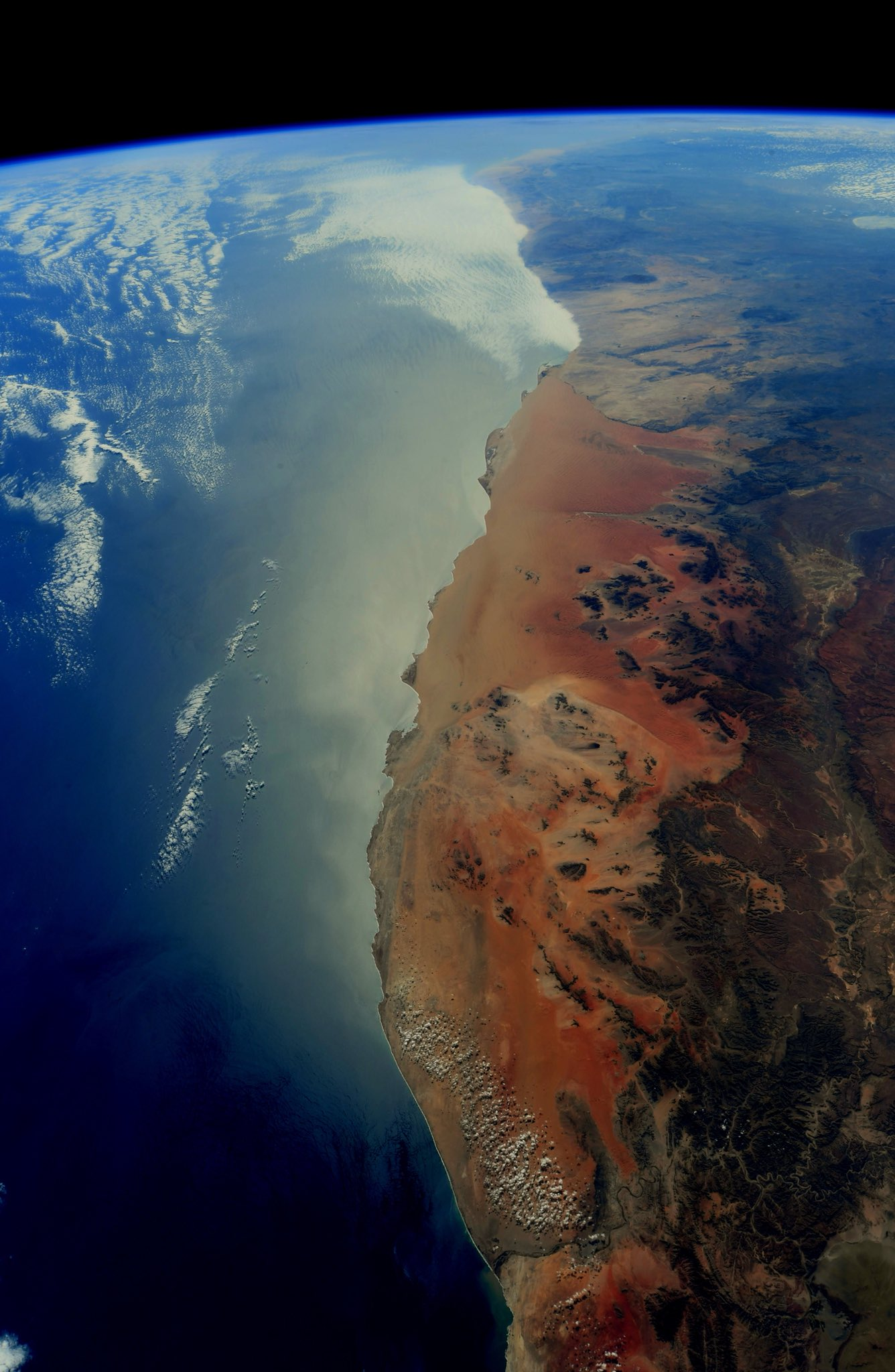 The ethereal beauty of Earth is our constant companion. It reminds us of all that we have left behind and what awaits when we return. The Skeleton Coast of the Namib Desert. #Namibia (Photo & Caption: Ricky Arnold / NASA)