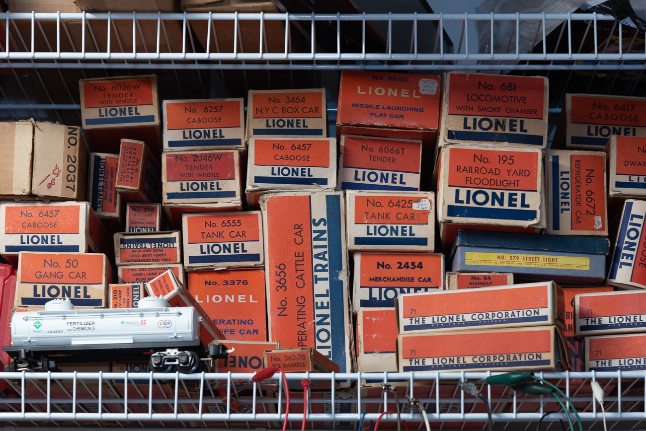 Vintage Lionel boxes line the shelf inside the workshop. / Image: Phil Armstrong, Cincinnati Refined // Published: 2.27.20