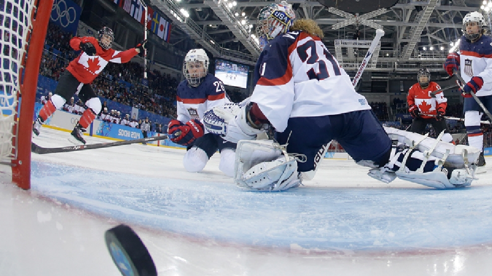 Goalkeeper Jessie Vetter and Kendall Coyne (26) of the United States look back at the puck as Meghan Agosta-Marciano, left, of Canada celebrates her goal during women's ice hockey game at the 2014 Winter Olympics, Wednesday, Feb. 12, 2014, in Sochi, Russia. Canada defeated the United States 3-2. (AP Photo/Matt Slocum, Pool)