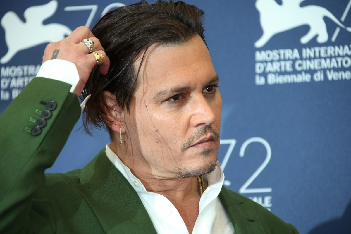 Johnny Depp poses for photographers at the photo call for the film Black Mass during the 72nd edition of the Venice Film Festival in Venice, Italy, Friday, Sept. 4, 2015. The 72nd edition of the festival runs until Sept. 12. (Photo by Joel Ryan/Invision/AP)