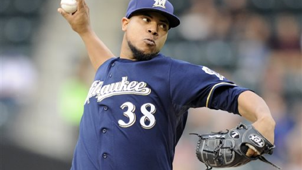 Milwaukee Brewers pitcher Wily Peralta delivers the ball to the New York Mets during the first inning of a baseball game on Wednesday, June 11, 2014, at Citi Field in New York. (AP Photo/Bill Kostroun)