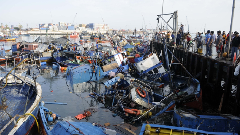 Fishing boats washed ashore by a small tsunami, sit in Caleta Riquelme, adjacent to the port, in the northern town of Iquique, Chile, after magnitude 8.2 earthqauke struck the northen coast of Chile, Wednesday, April 2, 2014. (AP Photo/Cristian Viveros)