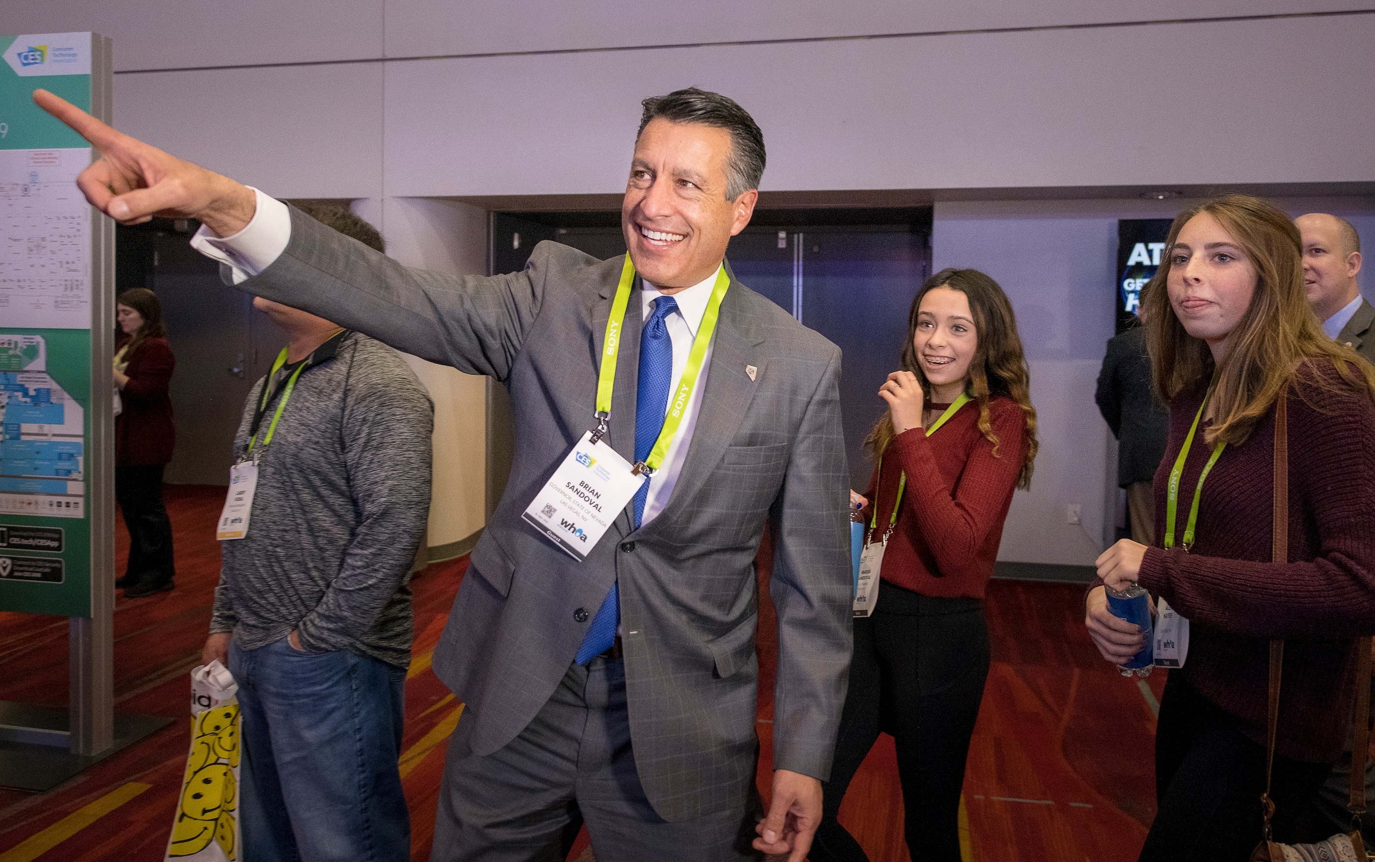 Nevada Governor Brian Sandoval, shows some of the sights of CES to his daughter Marisa Sandoval and her friend Alex Hayes as they tour  CES at the Las Vegas Convention Center on Thursday, Jan. 11, 2018. CREDIT: Mark Damon/Las Vegas News Bureau