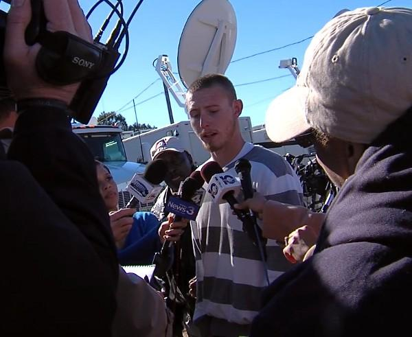 A resident speaks with the media in Midland City, Ala. on January 31, 2013 during a hostage standoff with the man suspected of shooting and killing a school bus driver in Dale County before kidnapping a child.