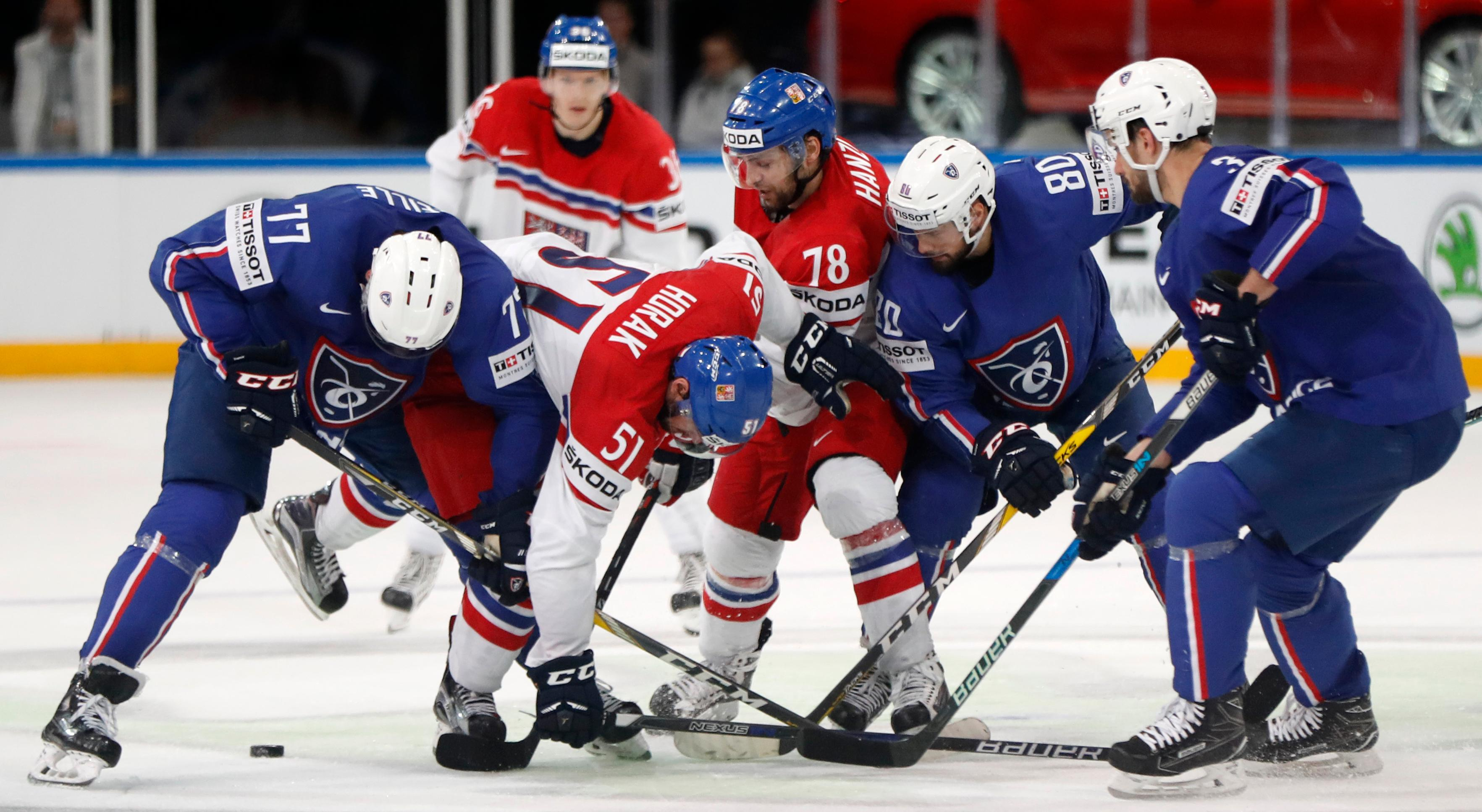Players scuffle for the puck during the Ice Hockey World Championships group B match between France and Czech Republic in the AccorHotels Arena in Paris, France, Sunday, May 14, 2017. (AP Photo/Petr David Josek)