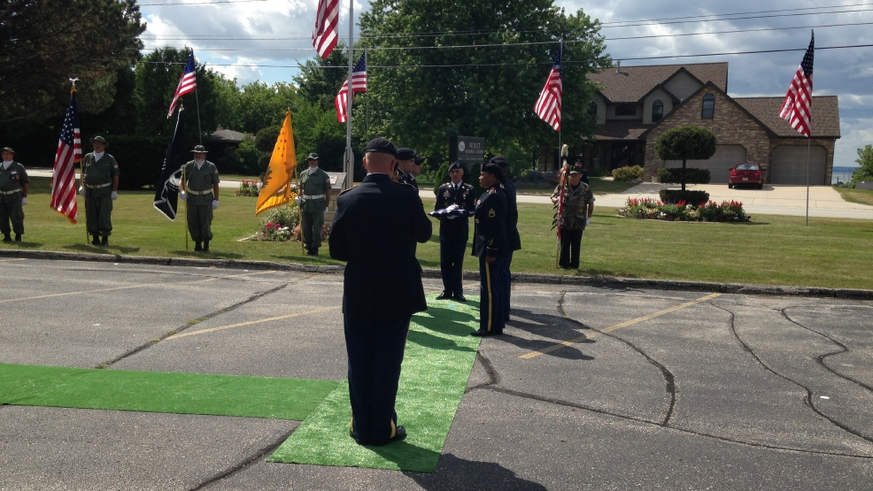 Army Staff Sergeant David Kittredge saluted with full military honors