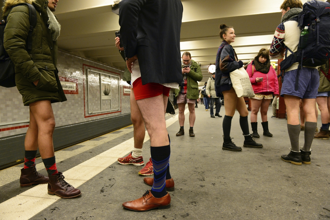 Young people with no pants wait for the subway train during the event  'No Pants Subway Ride' in Berlin, Germany,  Sunday Jan. 8, 2017.  What started in New York City in 2002 with a just a handful of people has blossomed into a worldwide movement involving thousands. No Pants rides are scheduled Sunday in about 50 cities across the U.S., Canada, Europe and Australia. (Maurizio Gambarini/dpa via AP)