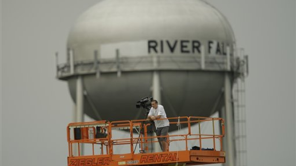 Kansas City Chiefs video crew member during NFL football training camp in River Falls, Wis., Sunday, Aug. 2, 2009. (AP Photo/Orlin Wagner)