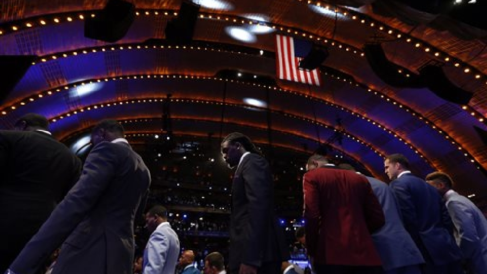 Jadeveon Clowney, center, from South Carolina, walks off stage after standing for a group photo with fellow draft prospects before the first round of the NFL football draft, Thursday, May 8, 2014, at Radio City Music Hall in New York. (AP Photo/Jason DeCrow)