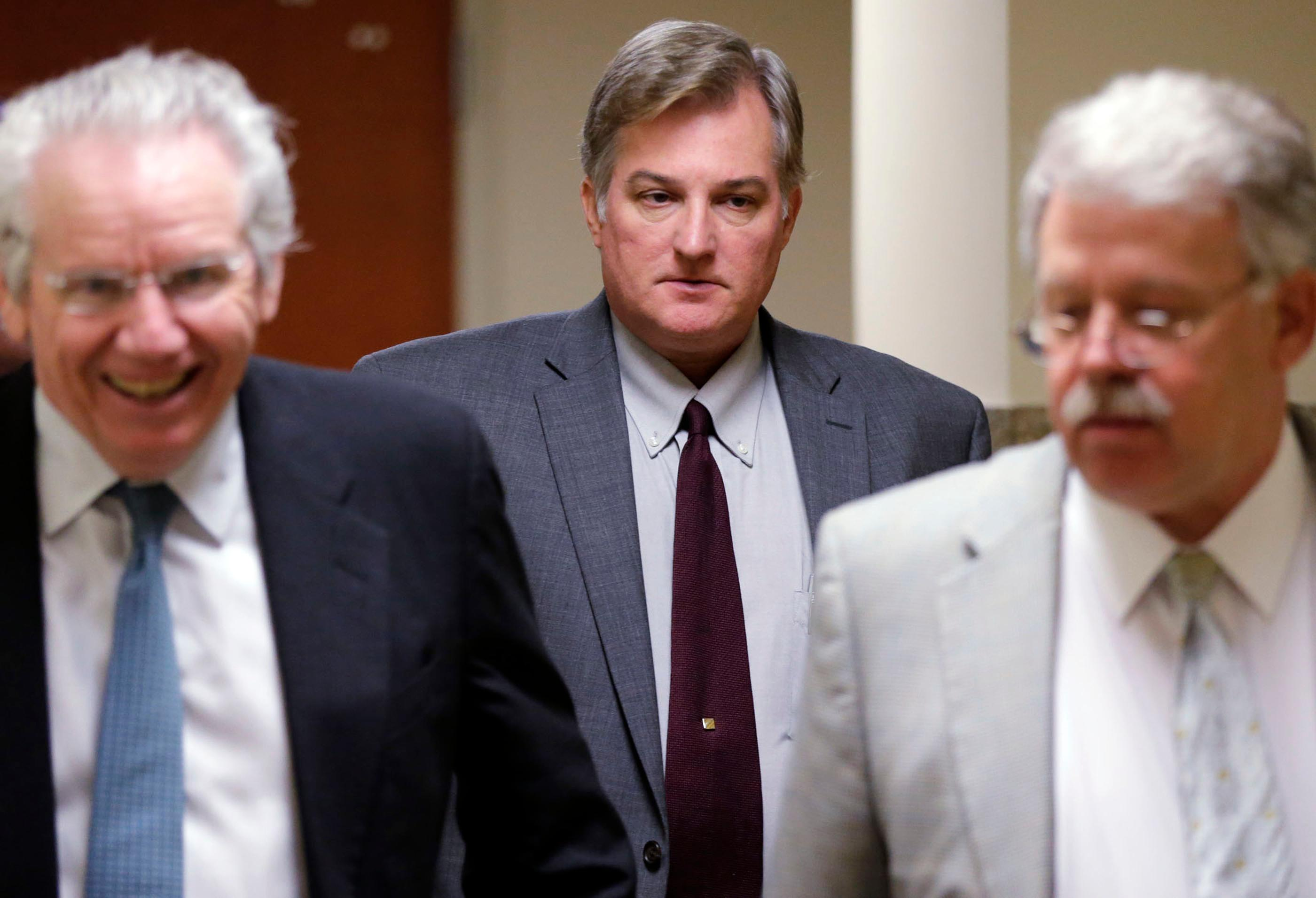 In this Thursday, June 29, 2017, photo, former Tulsa Police officer Shannon Kepler, center, exits the courtroom during his trial at the Tulsa County Courthouse, in Tulsa, Okla. Kepler, who accused of fatally shooting his daughter's new boyfriend in 2014, is on trial this week for the third time after jurors in the first two trials couldn't decide whether he was guilty of first-degree murder. (Cory Young/Tulsa World via AP)