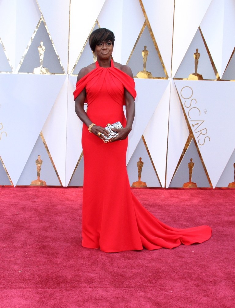 Now we've entered the portion of the discussion where I just can't make up my mind. I want to love Viola in this Armani because she can do no wrong in my eyes, but something is holding me back from declaring L-O-V-E. The color is perfection, her hair is magnificent but I don't think the peekaboo shoulders are my thing. (Image: Adriana M. Barraza/WENN.com)
