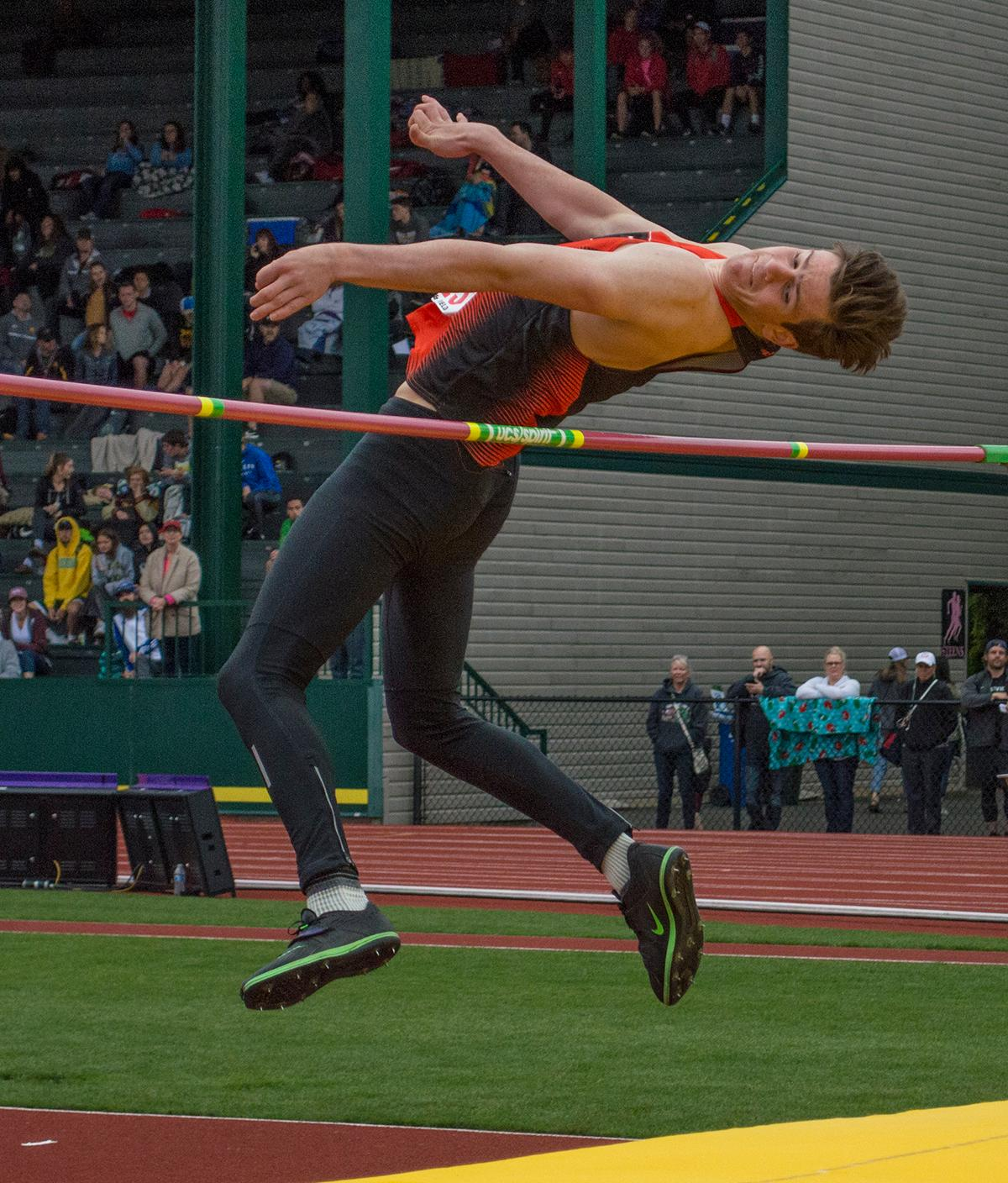 Beau Sheeran of Beaverton High School glides through the air at a height of 6-07.00, winning the 6A Boys High Jump event at the OSAA Track and Field Championships at Hayward Field. Photo by Emily Gonzalez, Oregon News Lab.