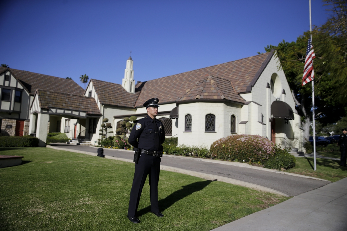 A police officer stands guard outside a mortuary where a small ceremony for former first lady Nancy Reagan will take place, Wednesday, March 9, 2016, in Santa Monica, Calif. (AP Photo/Jae C. Hong)