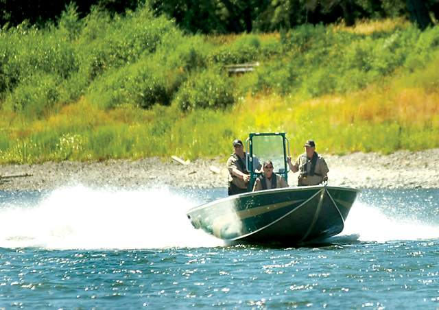 A look back at the week of July 4 to July 10, 2011. Jackson County Sheriff Search and Rescue comb the Rogue River Thursday afternoon after a report of a body seen floating near the 6000 block of Rogue River Highway. Mail Tribune / Julia Moore