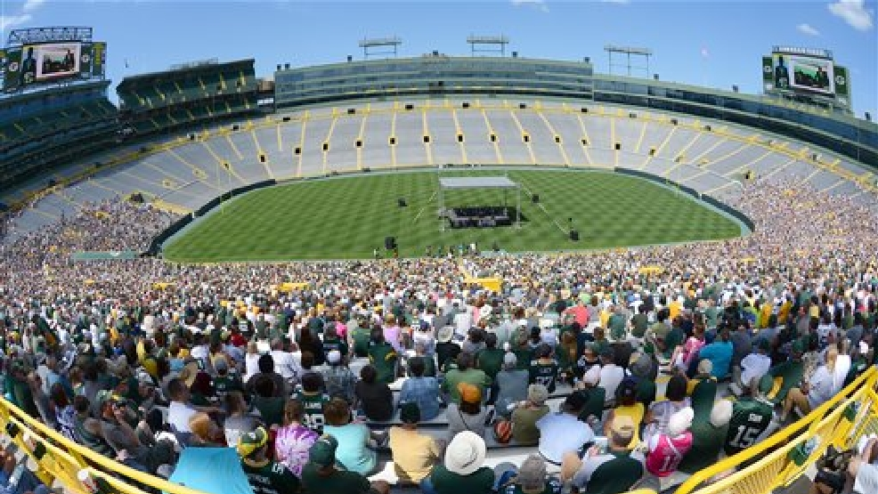 In this image taken with a  fish-eye lens, Green Bay Packers shareholders listen as president Mark Murphy addresses them from the stage inside Lambeau Field during the NFL football team's annual shareholders meeting Thursday, July 24 2014, in Green Bay. (AP Photo)