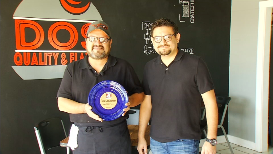 Israel and Raul Cepeda, owners of the restaurant, holding their Blue Plate Award. (News 4 San Antonio)<p></p>