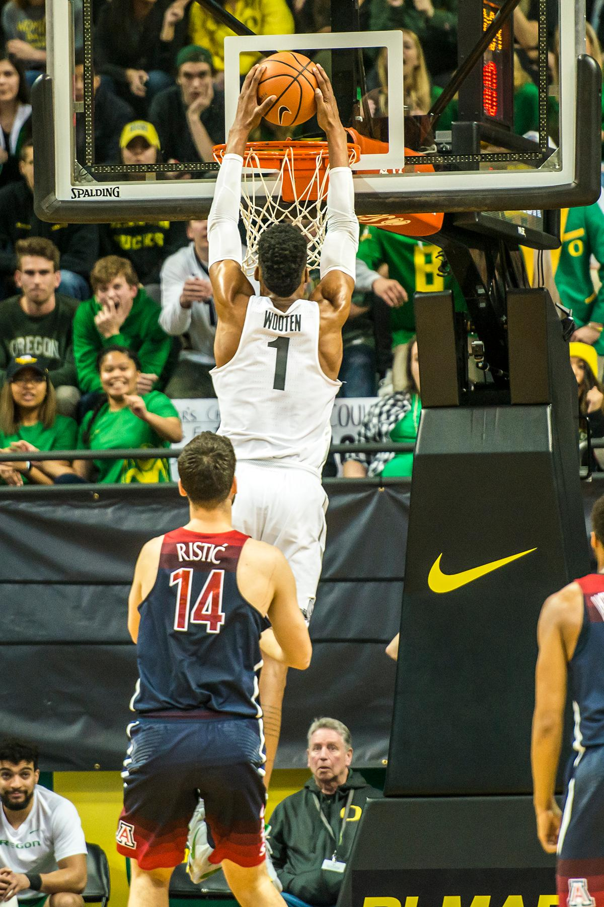 Oregon's Kenny Wooten dunks the ball against Arizona at Matthew Knight Arena Saturday. The Ducks upset the fourteenth ranked Wildcats 98-93 in a stunning overtime win in front of a packed house of over 12,000 fans for their final home game to improve to a 19-10 (9-7 PAC-12) record on the season. Oregon will finish out regular season play on the road in Washington next week against Washington State on Thursday, then Washington on the following Saturday. (Photo by Colin Houck)