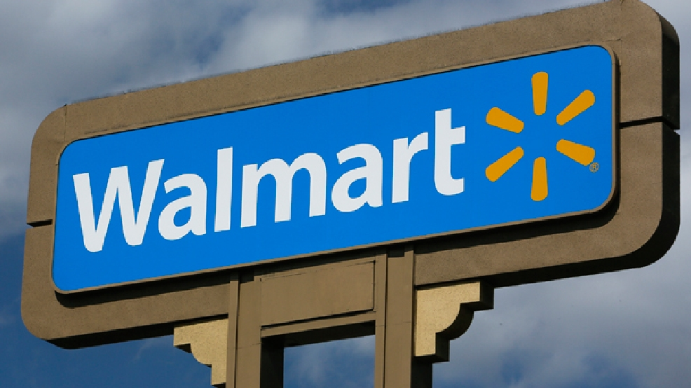 FILE - In this May 28, 2013, file photo, an outdoors sign for Walmart is seen in Duarte, Calif. (AP Photo/Damian Dovarganes)