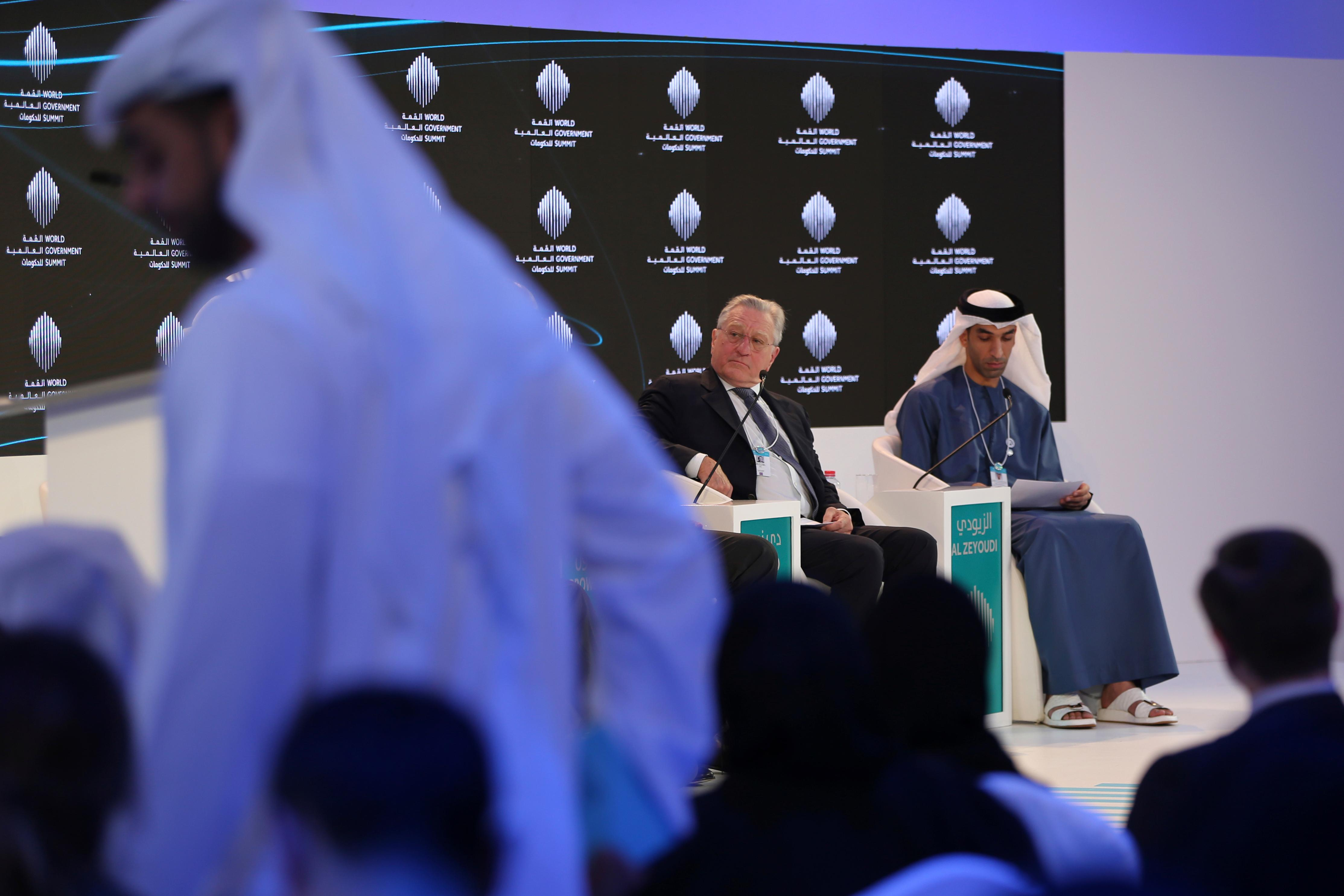 "American Hollywood star Robert De Niro listens to one of the panel speakers next to Dr. Thani Ahmed Al Zeyoudi the UAE Minister of Climate Change and Environment during the World Government Summit in Dubai, United Arab Emirates, Sunday, Feb. 11, 2018. De Niro took aim at the Trump administration's stance on climate change, telling a packed audience that he was visiting from a ""backward"" country suffering from ""temporary insanity."" (AP Photo/Kamran Jebreili)"