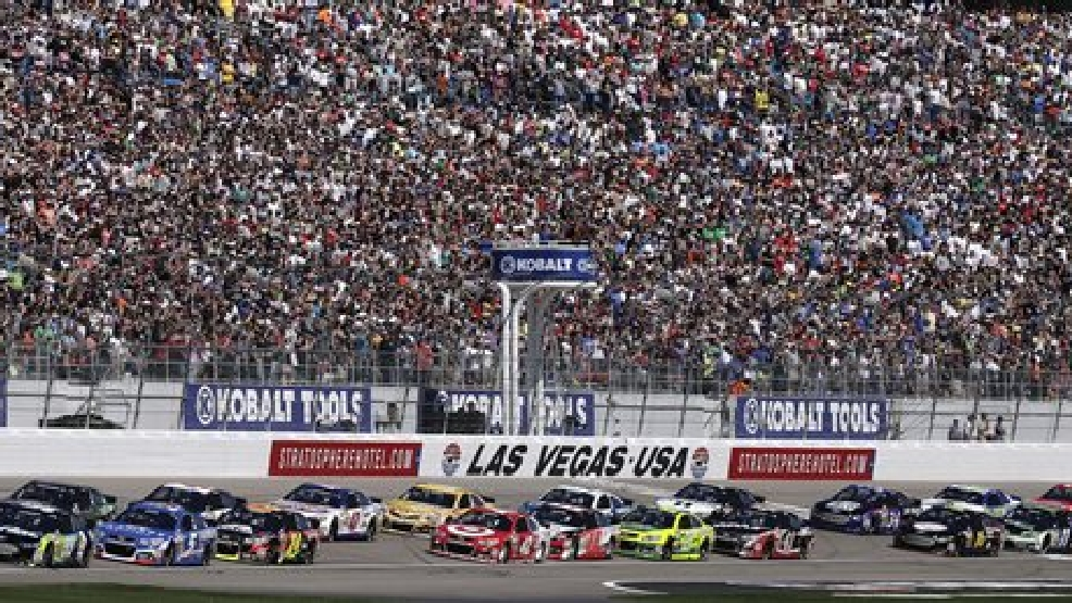 Drivers accelerate at the start of a NASCAR Sprint Cup Series auto race on Sunday, March 9, 2014, in Las Vegas. (AP Photo/Julie Jacobson)