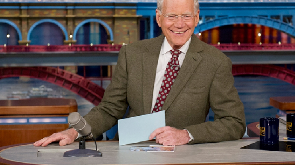 "In this photo provided by CBS, David Letterman, host of the ""Late Show with David Letterman,"" is seated at his desk in New York on Thursday, April 3, 2014. (AP Photo/CBS, Jeffrey R. Staab)"