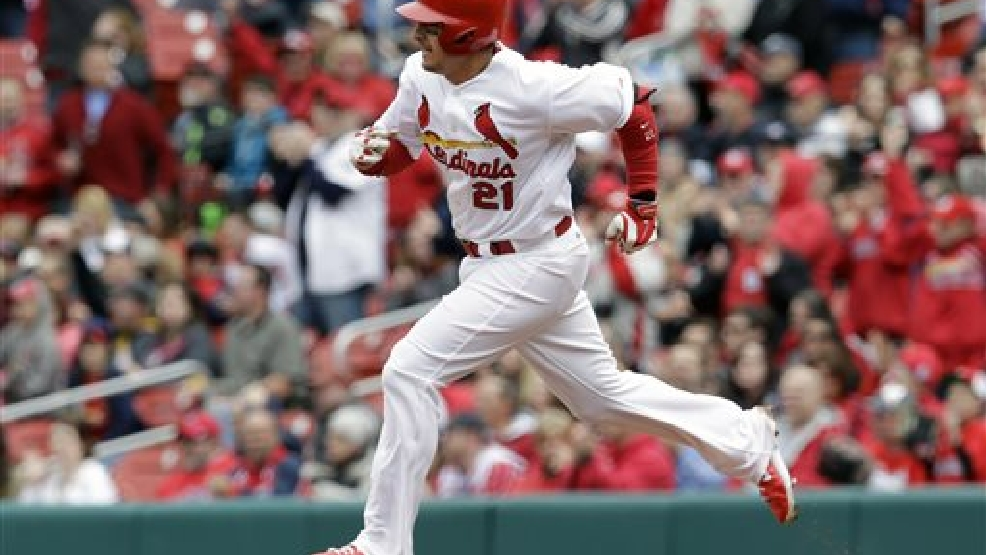 St. Louis Cardinals' Allen Craig heads to second on a two-run double during the fourth inning of a baseball game against the Milwaukee Brewers, Wednesday, April 30, 2014, in St. Louis. (AP Photo/Jeff Roberson)