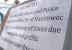 A Manitowoc dog park and lighthouse access trail remain closed after being struck by vandals.