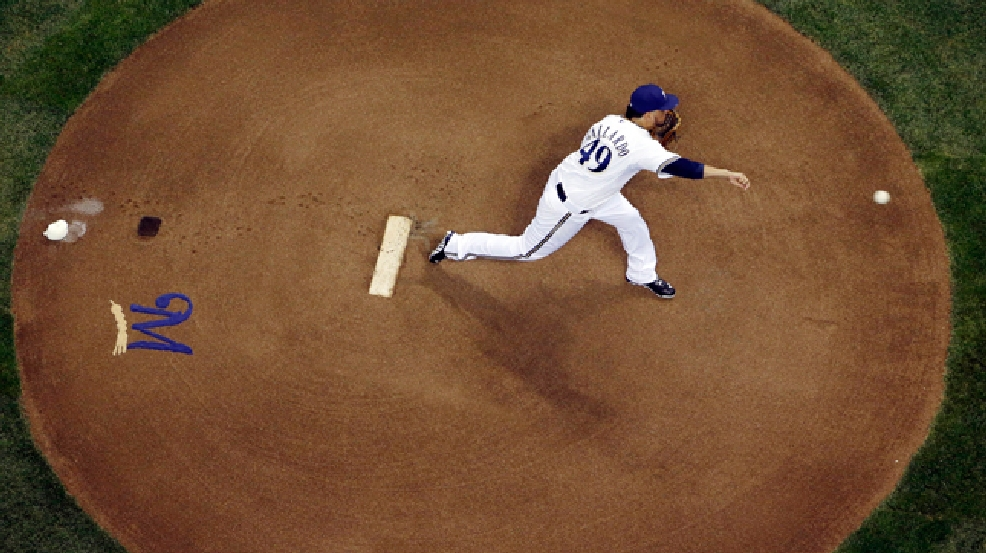 Milwaukee Brewers starting pitcher Yovani Gallardo throws during the first inning of a baseball game against the Baltimore Orioles on Wednesday, May 28, 2014, in Milwaukee. (AP Photo/Morry Gash)