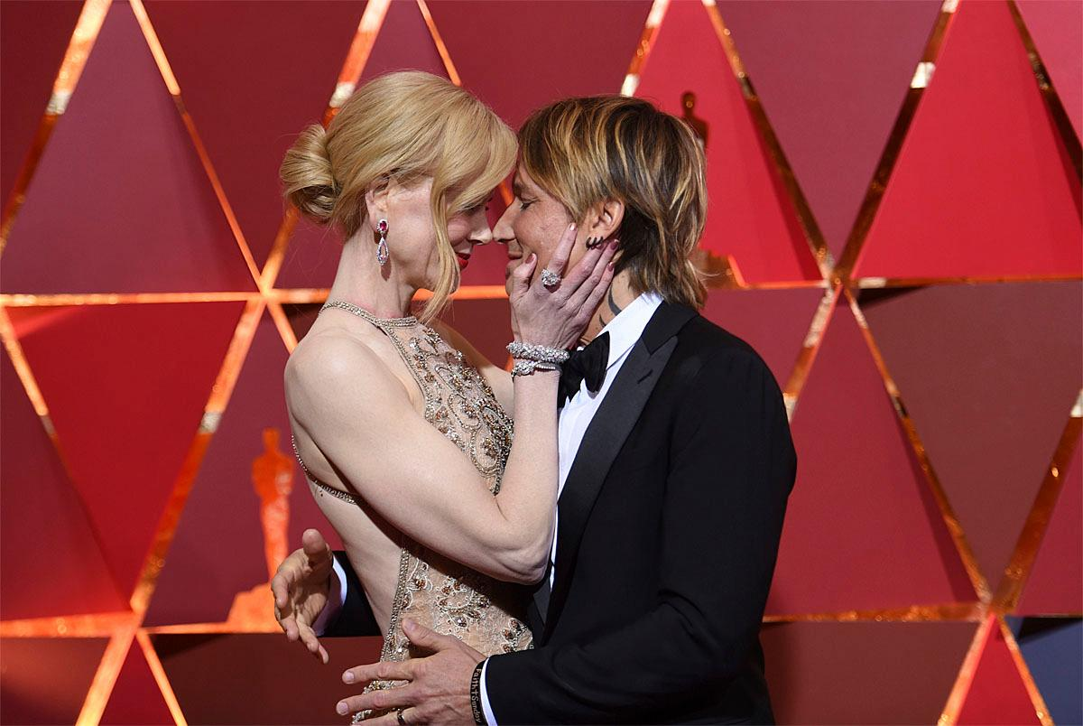 Nicole Kidman, left, and Keith Urban arrive at the Oscars on Sunday, Feb. 26, 2017, at the Dolby Theatre in Los Angeles. (Photo by Richard Shotwell/Invision/AP)