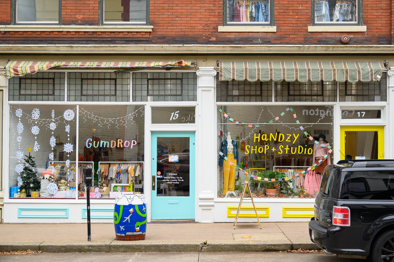 Gumdrop, a baby and toddler store run by the owners of Handzy, now occupies Handzy's former space on Pike Street. They're side by side on Pike Street. / Image: Phil Armstrong, Cincinnati Refined // Published: 12.18.19