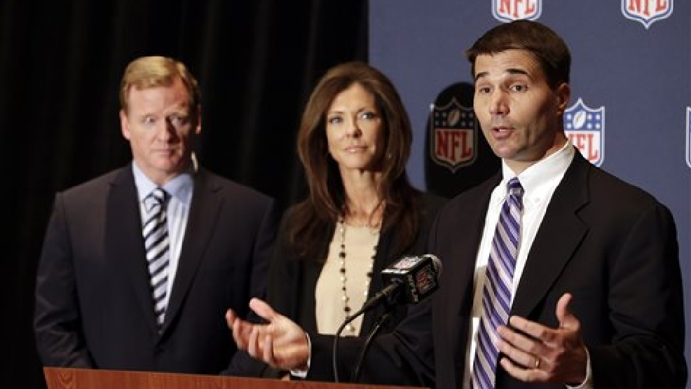 Scott Hallenbeck, right, USA Football's executive director speaks as NFL Commissioner Roger Goodell, left, and NFL Foundation Chair Charlotte Jones Anderson, center, listen during a news conference at the NFL football annual meeting in Orlando, Fla., Monday, March 24, 2014. The NFL Foundation is giving USA Football a five-year, $45 million grant to expand the already burgeoning Heads Up Football program that teaches safe tackling to youngsters. (AP Photo/John Raoux)