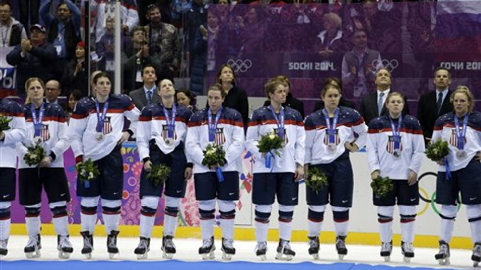 Team USA reacts after receiving their silver medals after losing to Canada 3-2 in overtime of the gold medal women's ice hockey game at the 2014 Winter Olympics, Wednesday, Feb. 19, 2014, in Sochi, Russia. (AP Photo/David Goldman)
