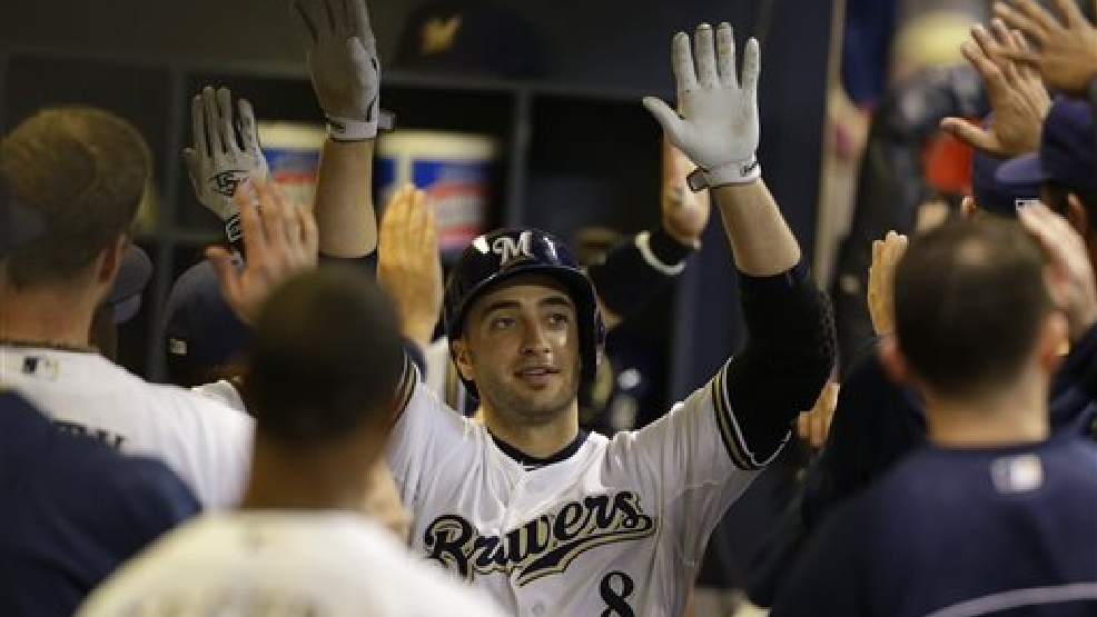 Milwaukee Brewers' Ryan Braun is congratulated after his two-run home run against the Cincinnati Reds in the eighth inning of a baseball game on Saturday, June 14, 2014, in Milwaukee. (AP Photo/Jeffrey Phelps)