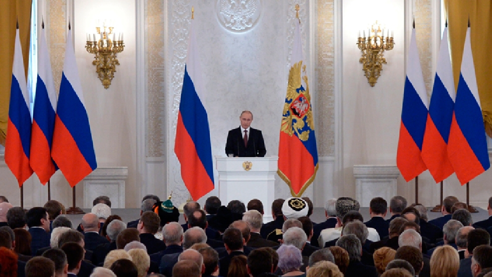 Russian President Vladimir Putin addresses the Federal Assembly in the Kremlin in Moscow, Tuesday, March 18, 2014. With a sweep of his pen, President Vladimir Putin added Crimea to the map of Russia on Tuesday, describing the move as correcting past injustice and a response to what he called Western encroachment upon Russia's vital interests. (AP Photo/RIA-Novosti, Alexei Druzhinin, Presidential Press Service)