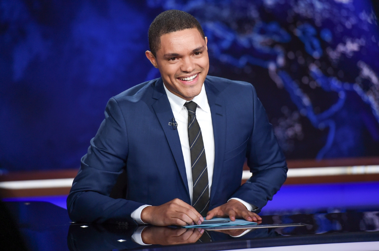"FILE - In this Sept. 29, 2015 file photo, Trevor Noah appears on set during a taping of ""The Daily Show with Trevor Noah"" in New York. Host Noah and comedians Lewis Black and Brian Regan will be the headliners at the Lucille Ball Comedy Festival in August 2016. The annual festival takes place in Lucille BallÂ?s hometown of Jamestown each year.  (Photo by Evan Agostini/Invision/AP, File)"