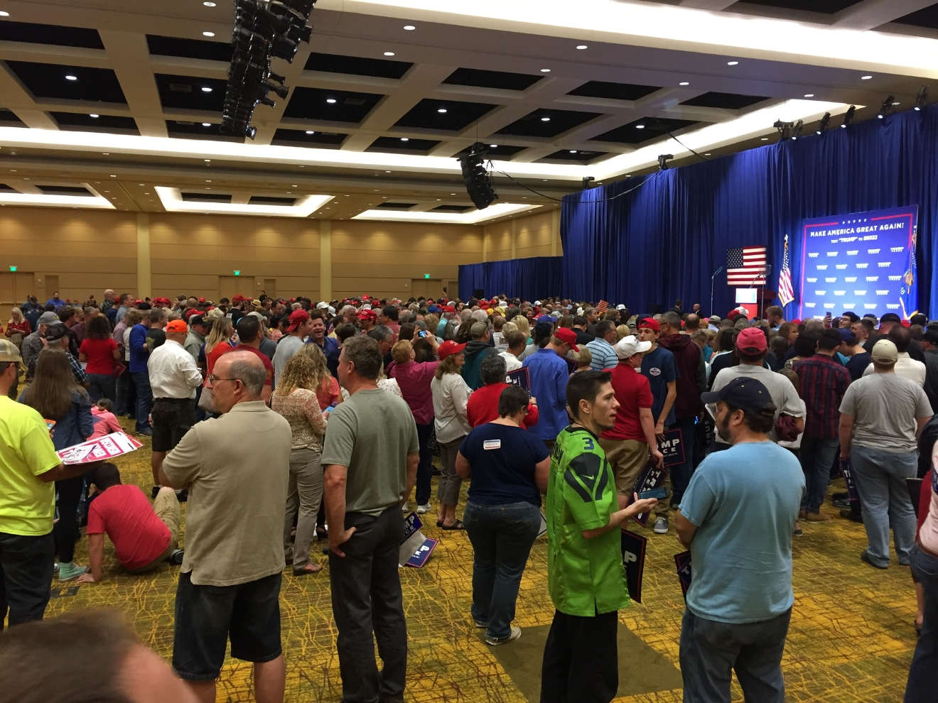 People gather inside the KI Convention Center in Green Bay, Wisc. ahead of a Donald Trump rally, Monday, Oct. 17, 2016. (WLUK/Andrew LaCombe)