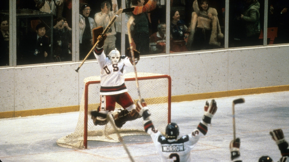 Jim Craig  jumps with jubilation after the U.S. beat the Soviet Union 4-3 in an Olympic semifinals on Feb. 22, 1980, during the Winter Olympics in Lake Placid, N.Y. The game was dubbed The Miracle On Ice. (Photo by Focus on Sport/Getty Images)