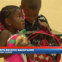 Former Rogers High School student provides new backpacks to current students