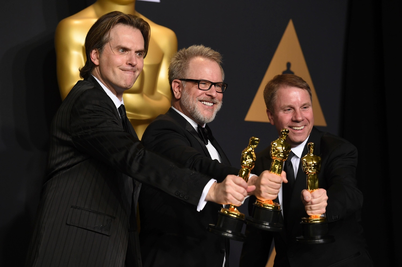 "Byron Howard, from left, Rich Moore and Clark Spencer pose in the press room with the award for best animated feature film for ""Zootopia"" at the Oscars on Sunday, Feb. 26, 2017, at the Dolby Theatre in Los Angeles. (Photo by Jordan Strauss/Invision/AP)"