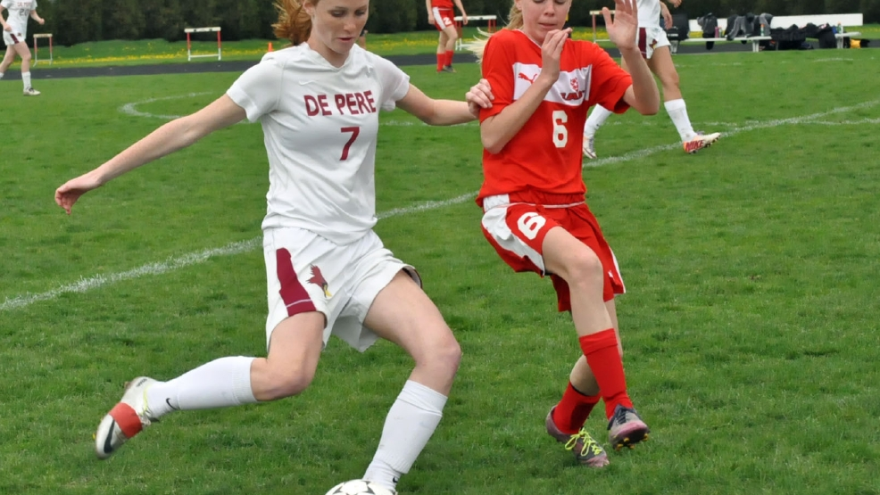 De Pere's Lauren DeMille looks to pass as Green Bay East's Hope Cerney defends during their game Wednesday. (Doug Ritchay/WLUK)