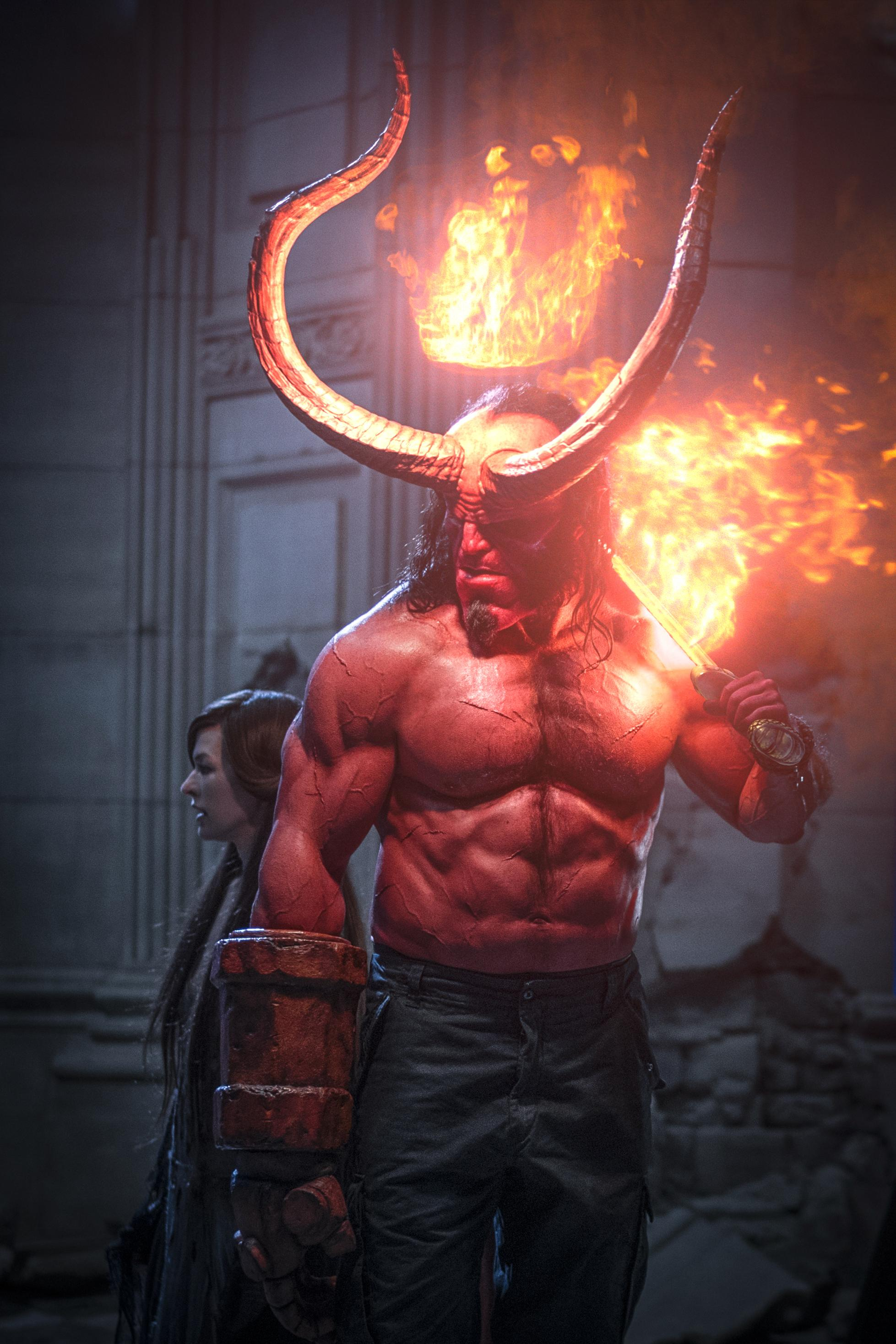 Milla Jovovich as 'Nimue the Blood Queen' and David Harbour as 'Hellboy' in HELLBOY. (Photo: Mark Rogers, Lionsgate)