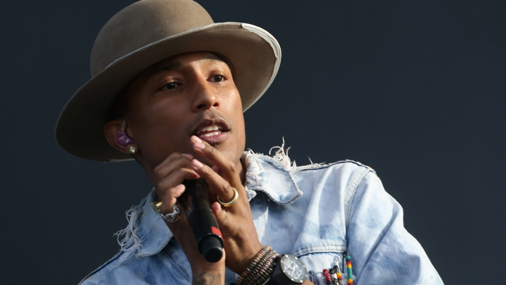 FILE - In this Friday, July 4, 2014, file photo, Pharrell Williams performs on the main stage at Wireless festival in Finsbury Park, in London. Pharrell will perform outside of CenturyLink Field in Seattle on Sept. 4, 2014, before the Seattle Seahawks play the Green Bay Packers in an NFL football game, as the NFL kicks off its 95th season. (Photo by Joel Ryan/Invision/AP, File)