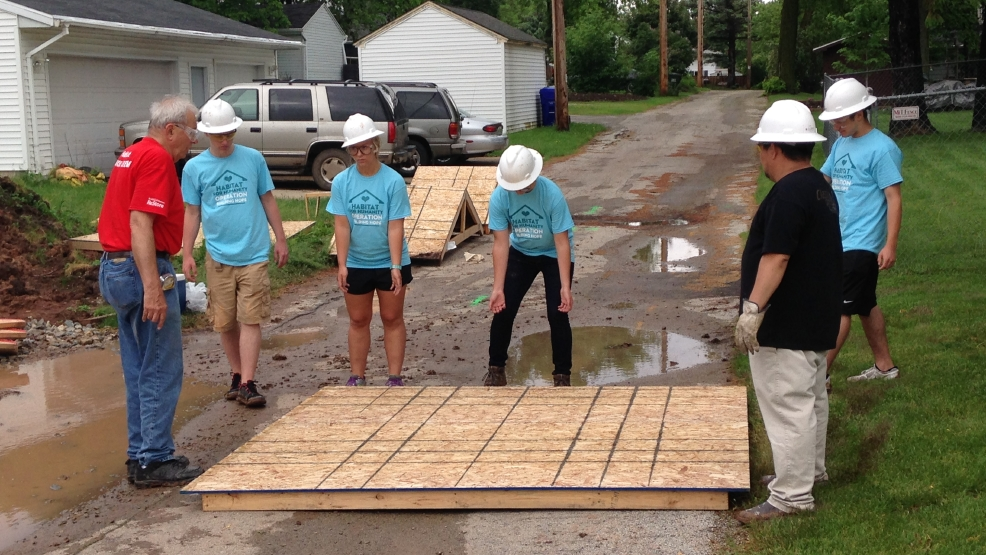 A group of students from 7 Fox Valley area high schools build a Habitat for Humanity House, June 2, 2014. (WLUK/Chad Doran)