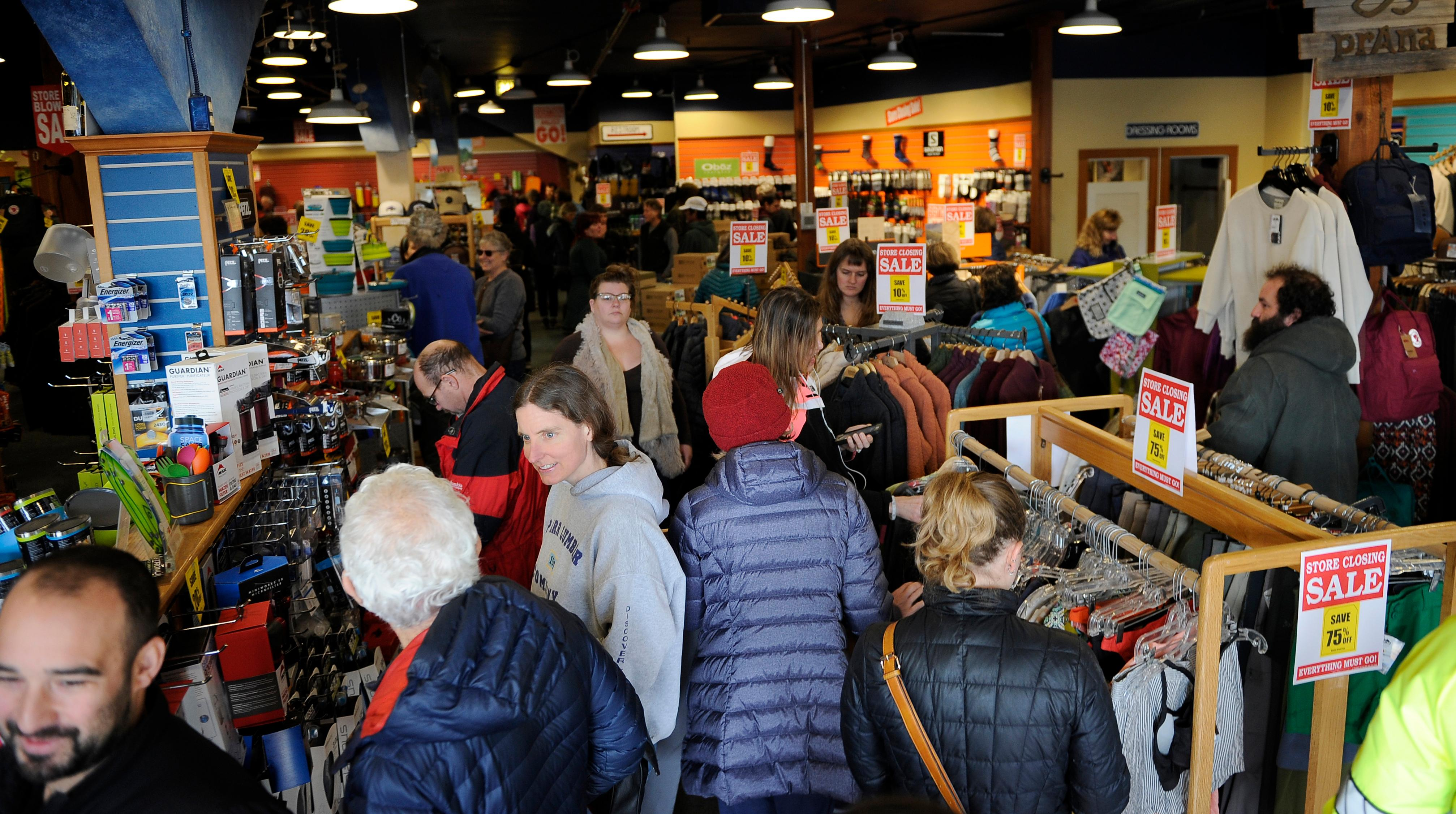 Andy Atkinson / Daily Tidings<br>Customers crowd into the Ashland Outdoor Store Wednesday morning for their liquidation sale before closing the doors.