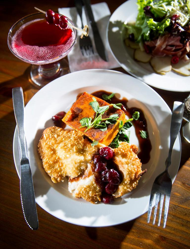 The goat cheese and cranberry stuffed chicken breast, with a butternut squash polenta cake, wilted spinach, and cranberry Demi-glace, at the Salt Hotel and Pub, located at 147 Howerton Ave, Ilwaco, WA. (Sy Bean / Seattle Refined)<p></p>