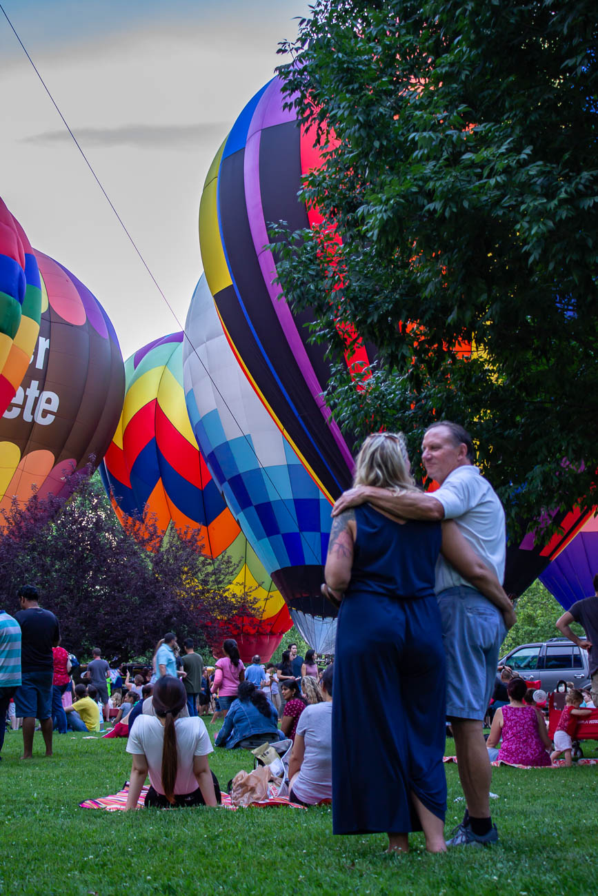 Over a dozen hot air balloons illuminated the sky as the sun set. They were organized by balloon meister Brian Trapp, who has coordinated the display every year. Visitors were able to walk around and see them up-close. / Image: Katie Robinson, Cincinnati Refined // Published: 7.4.19<p></p>