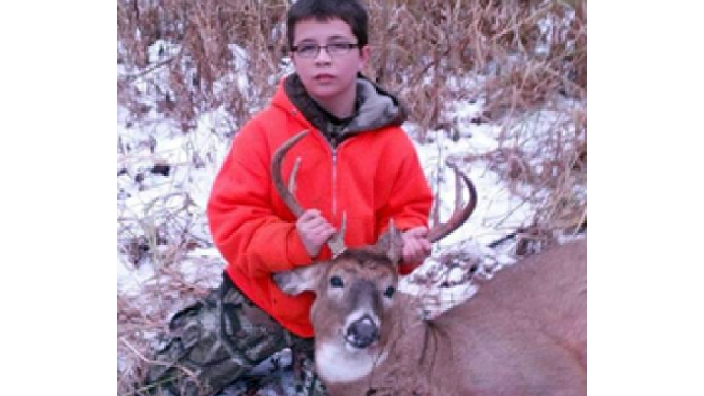 Kameron Jorgenson poses with a nine point buck.